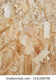 Weathered Oriented Strand Board. OSB. Flakeboard. Sterling board. Aspenite. Wood grain texture. Vertical detail.