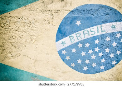 Weathered painted mural of the bandeira do Brasil Brazilian flag on textured stone wall