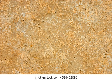 Weathered and pitted sandstone slab background texture