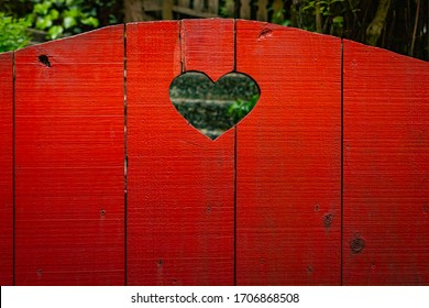 Weathered Red Wooden Gate with Heart Cut Out