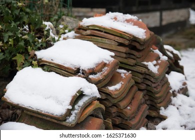 Weathered Roof Tiles Stacked in the Snow