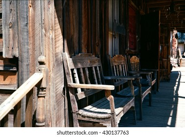 Weathered rural wooden benches on front porch