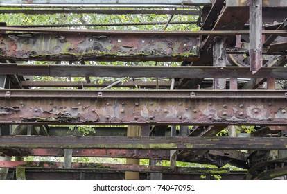 weathered rusty detail showing a et away steel girders