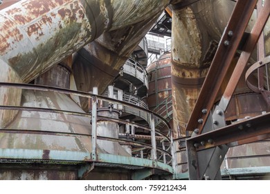 weathered rusty industrial scenery with old corroded steel girders and metal tubes