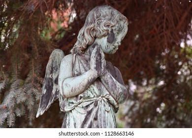 Weathered sculpture of a praying angel on a tomb of a cemetery in Berlin-Germany & Alone In Shadow Images Stock Photos u0026 Vectors | Shutterstock