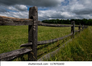 Weathered split rail fence at a horse farm in Upper Freehold Township, New Jersey.