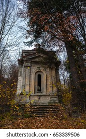 A weathered spooky crypt in the forest late autumn.