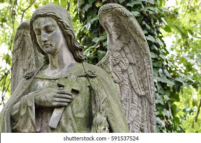Weathered statue of an Angel - tombstone - old Prague cemetery, Czech republic, Europe