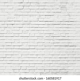 Weathered texture of stained old dark white and gray brick wall background, grungy rusty blocks of light stone-work technology, colorful horizontal architecture