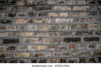 Weathered texture of stained old dark brown and red brick wall background, grungy rusty blocks of stone-work technology, colorful horizontal architecture