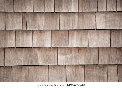 Weathered tiles or shingles typical of the northwestern pacific coast: wooden texture and geometrical patterns