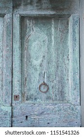 Weathered traditional wooden panelled door.