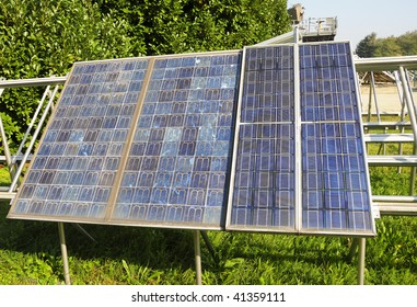 Weathered twenty-year old solar panels on an outdoor test rack