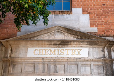 Weathered vintage chemistry sign on building in American university campus.