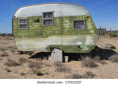 Weathered Vintage Travel Trailer in Sonoran Desert