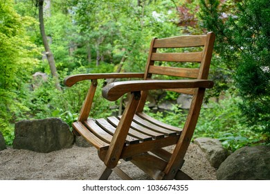 weathered wood chair sitting outside in japanese zen garden