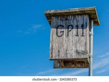 weathered wooden bird's nesting box in the Texas Hill Country with copy space
