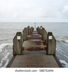 Weathered wooden jetty in Aberystwyth, Wales UK.