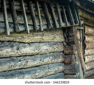 Weathered wooden logs wall of rural house background