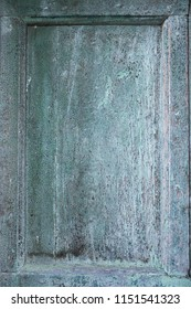 Weathered wooden panel with distressed paint.