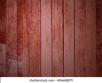 Weathered wooden planks with light red color