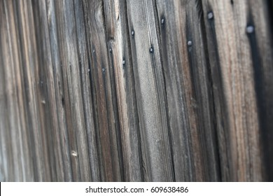 Weathered wooden planks on an old shed in New England