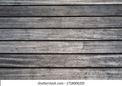 weathered wooden planks of seaside dock for background and texture