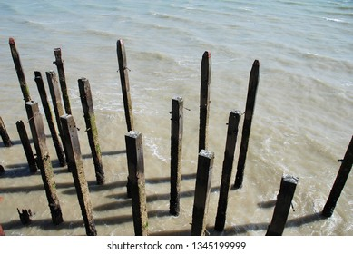 Weathered wooden posts at the end of the Victorian pier at Hastings in East Sussex, England.