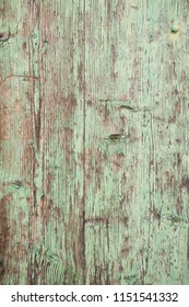 Weathered wooden surface with distressed paint.