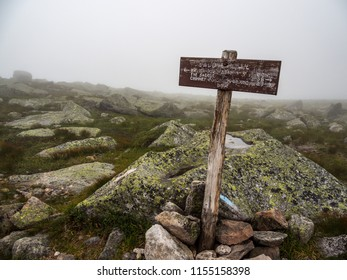 Weathered wooden trail sign on rocky slope of Katahdin, Baxter State Park, Maine.
