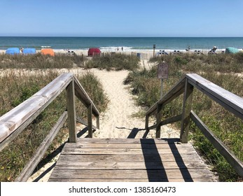Weathered wooden walkway to the beach.
