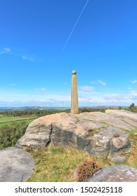 Weathered and worn, Nelsons monument stands on the gritstone rocks of Birchen Edge under a blue September sky.