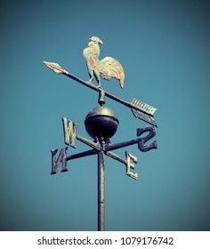 weathervane also called weathercock with vintage effect and blue sky on background