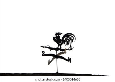 "Weathervane on the roof ""Rooster"". Metal cock on the house."