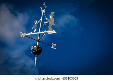 Weathervane Set Against Blue Moody Sky