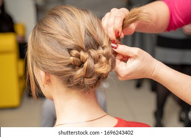 weave braid girl in a long hair salon