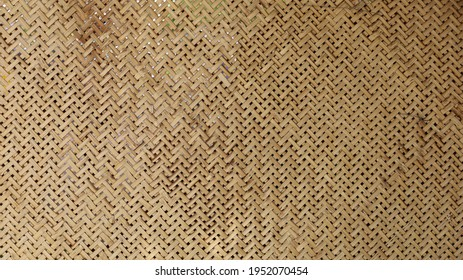 Weave pattern background and bamboo texture. The ancient classic pattern of bamboo wickerwork is part of traditional Thai appliances for the background and wallpaper. Selective focus