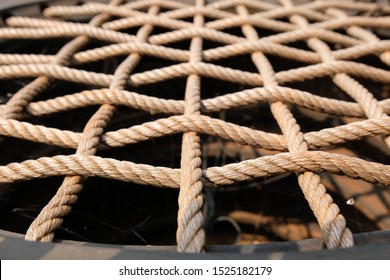 Weave the rope on the old car tire  Recycling of waste materials for furniture  Artificial chair