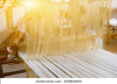 weave silk cotton on the manual wood loom in laos ,thailand,selective focus,vintage color
