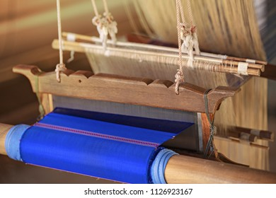 Weave Silk,Silkworm Praewa Ban Phon at Kalasin,Thailand,Silk clothes from nature material,Weaving carpet with traditional techniques on  loom,Wool yarns used as a warp and weft is crucial for this art