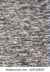Weaved texture of a material. Linen natural grey fabric, square pattern, close up. Silk pattern. Cotton weft or white yarn. Abstract texture. Vintage background of black and white elements