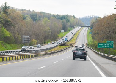 Weaverville, USA - April 19, 2018: Smoky Mountains near Asheville, North Carolina and many cars on i26 highway with sign