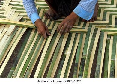 Weaving a bamboo mat,  Hsipaw,  Myanmar (Burma)
