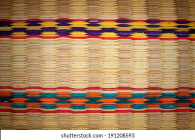 weaving colorful palm leaves mats
