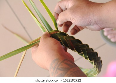 Weaving a headband by using the local palm trees. Its part of the cultural program in Samoan Cultural Village , Apia.