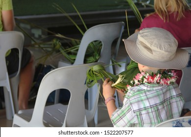 Weaving a headband by using the local palm trees. Its part of the cultural program in Samoan Cultural Village , Apia. a kid enjoying his headband course.