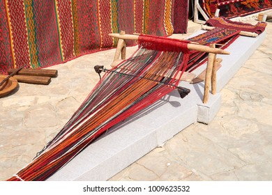 Weaving machine for carpet. Weaving machine is the main weaving machine, equipment or device for manufacturing all kinds of pile, smooth, woven clothes and carpets: linen, hemp, cotton, silk and wool.