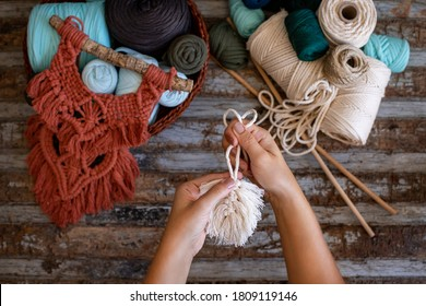 Weaving macrame at home. Hand of a woman when she is making macrame.