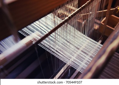 Weaving, making traditional Japanese textiles.