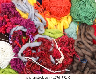 weaving material. bundle of fluffy thick twine yarn wool all jumbled up together  abstract color sewing knitting fabric for textiles art craft and design. Haberdashery concept. colourful, colorful.